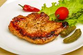 stock photo of roasted pork  - Roasted pork with pepper and salad leaves - JPG