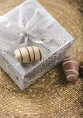 stock photo of gift wrapped  - A wrapped gift box and date chocolates from top angle - JPG