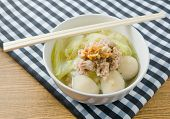 pic of thai cuisine  - Thai Cuisine and Food A Bowl of hinese Cabbage with Minced Pork and Fish Meat Ball Soup Topping with Fried Garlic - JPG