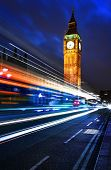 picture of london night  - Big Ben one of the most prominent symbols of both London and England as shown at night along with the lights of the cars passing - JPG