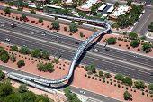 picture of pedestrians  - A pedestrian cyclist bridge spanning the Loop 101 freeway in Chandler Arizona - JPG