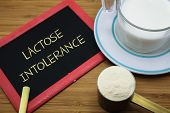 image of milk  - Lactose intolerance word on chalk board with a cup of milk and milk powder - JPG