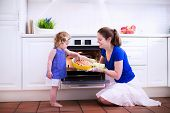 pic of helping others  - Mother and child bake a pie - JPG