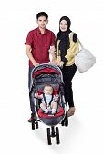 image of muslim kids  - Portrait of two young muslim parents with male baby on the pram isolated on white - JPG