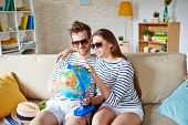 image of amor  - Amorous couple in sunglasses choosing place for travel and rest - JPG