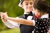 stock photo of waltzing  - Lovely young couple dancing and having fun - JPG