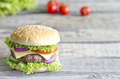 foto of hamburger-steak  - Hamburger on vintage wooden board closeup with spices - JPG