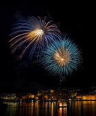 Постер, плакат: Colorful fireworks explode in Malta in dark sky Malta fireworks festival 4 July Independence