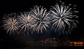 Постер, плакат: Big colorful fireworks explode in Malta in dark sky Malta fireworks festival 4 July Independence