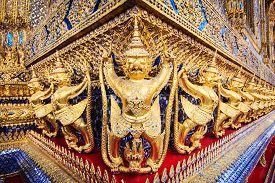 picture of garuda  - Golden garuda statues at Wat Phra Kaew in Grand Palace Bangkok Thailand - JPG