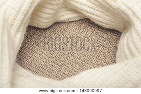 White scarf on sackcloth. Background for your text placement.