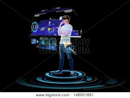 3d technology, augmented reality, gaming, cyberspace and people concept - happy young man in virtual reality headset or 3d glasses with gps navigator projection over black background