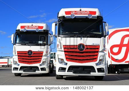 NAANTALI FINLAND - SEPTEMBER 16 2016: Mercedes-Benz Actros 2551 cargo trucks of the new visual identity of Ahola Transport on display on the company Open Doors event in Naantali Finland.