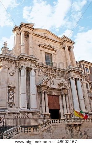 The facade of St Francesco Borgia Church decorated with giant stone columns and sculptures of the Saints Catania Sicily Italy.