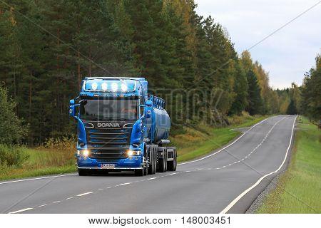 SALO, FINLAND - SEPTEMBER 17, 2016: Blue Scania R580 tank truck for bulk transport trucking along rural highway.