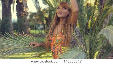 Smiling young woman enjoying a tropical vacation