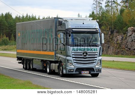 PAIMIO, FINLAND - SEPTEMBER 18, 2016: Mercedes-Benz Actros Flowertrucks semi for flower transport moves along freeway in South of Finland in autumn.