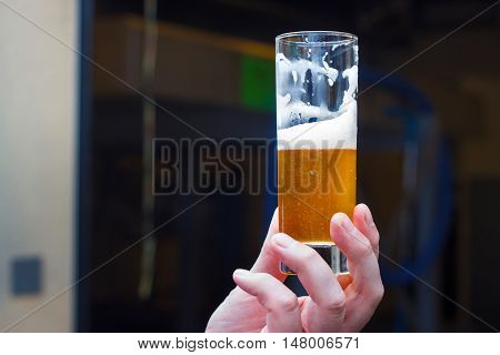 Belgian lambic (geuze) beer glass in hand.