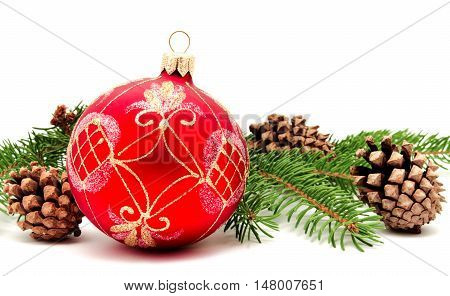 Christmas decoration ball with fir cones and fir branches isolated on a white background