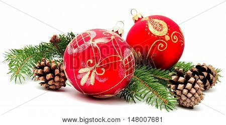 Christmas decoration balls with fir cones and fir branches isolated on a white background