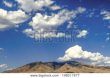 Mount Ara ler in sunny day against the blue sky covered by clouds