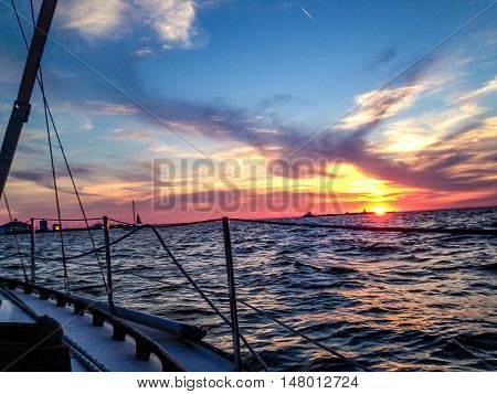 looking at the lake with sailboats and sunset