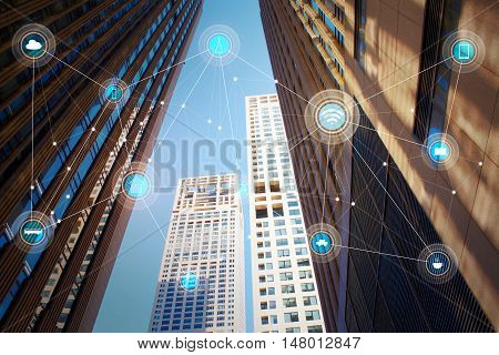 Looking up lower angle exterior commercial building and wireless communication network abstract image visual internet of things .