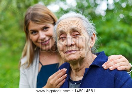 Portrait of an old woman spending time with her granddaughter