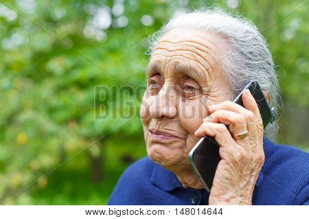 Picture of a happy old woman talking on cell phone