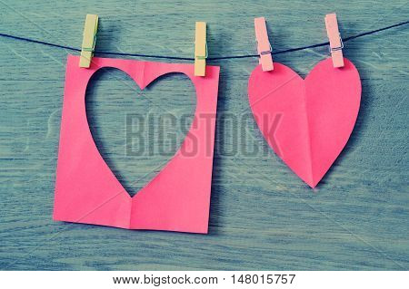 Red Paper Heart Hanging On The Clothesline.