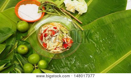 Papaya Salad in glass dish and noodle Thai Isan favorite herbal green food for diet control