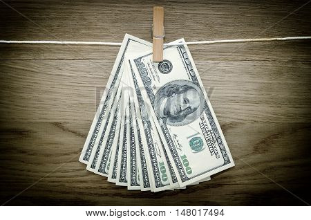 Dollar Bills Hanging On A Clothes Pins