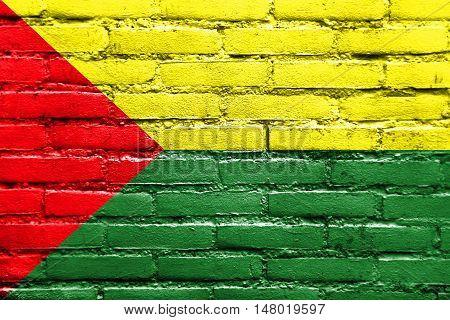 Flag of Santa Rosa Ecuador painted on brick wall