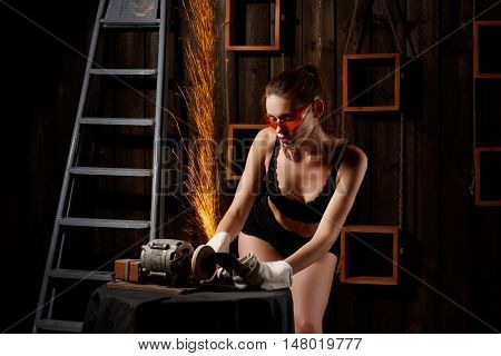 beautiful girl in sexy black lingerie and sunglasses welding