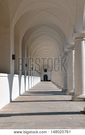 Classical white colonnade with sharp shadows in perspective. Dresden, Germany