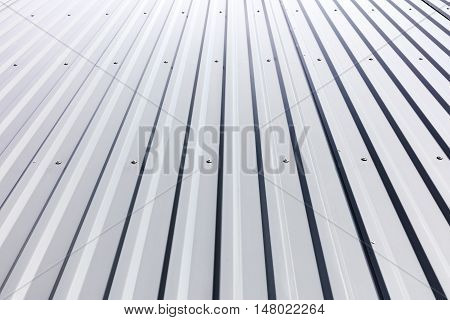 Corrugated Steel Cladding With Rivets On Industrial Building