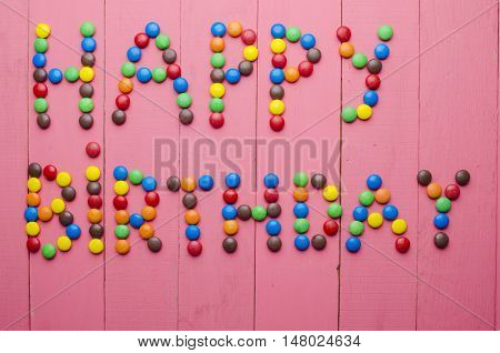 Inscription From Candies On A Pink Background