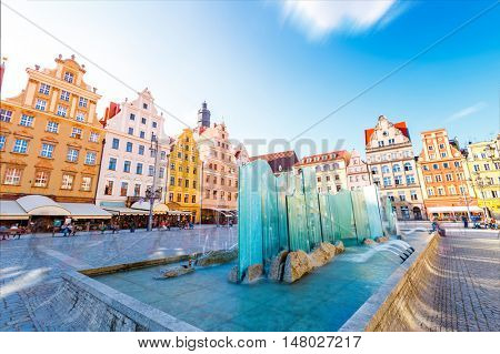 Fantastic view of the ancient homes on a sunny day. Gorgeous picture and picturesque scene. Location famous Market Square in Wroclaw, Poland, Europe. Historical capital of Silesia. Beauty world.