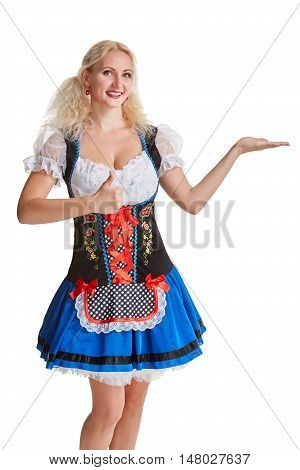 Beautiful young blond girl in dirndl drinks out of oktoberfest beer stein. Isolated on white background. pointing finger and smiling. copyspace desing concept