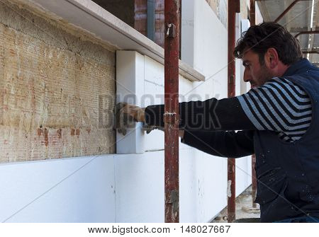 Construction site - Installing external insulation Facade therm