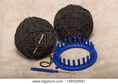 two coil gray natural wool for knitting socks on circular loom