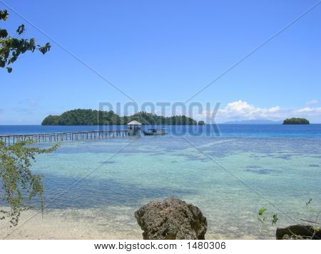 Boat On The Pier Of A Tropical Beach, Togians Island, Sulawesi, Indonesia