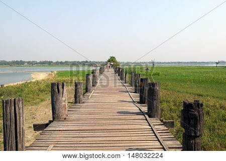 Long, rickety wooden bridge near Mandalay, Burma