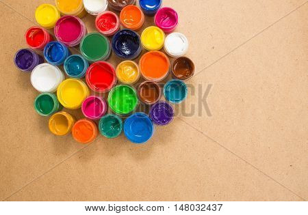 Colorful paint cans on wooden background. Place for your text