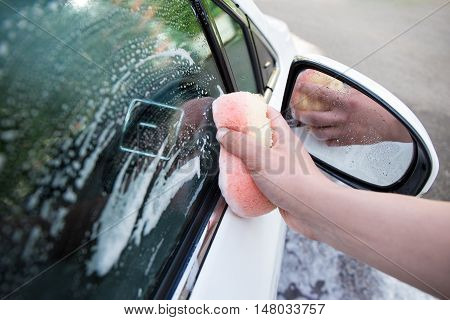 Close Up Of Handle Car Washing With Sponge And Soap
