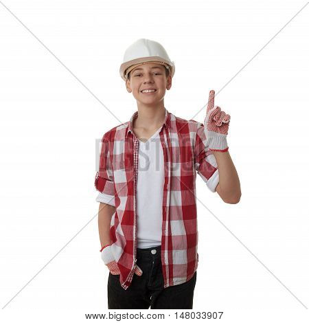 Cute teenager boy in red checkered shirt and building helmet pointing up over white isolated background, half body, constructing concept