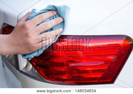 Male Hand Washing Car With Microfiber Cloth