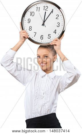 Beautiful young businesswoman holding up a wall clock