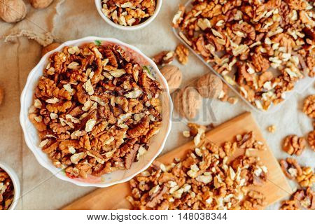 Assortment Of Nuts. Bowl Of Walnuts On Wooden Texture. Walnuts A