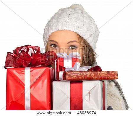 Young Woman In Winter Clothes Peeking From Behind Presents Close-up - Isolated